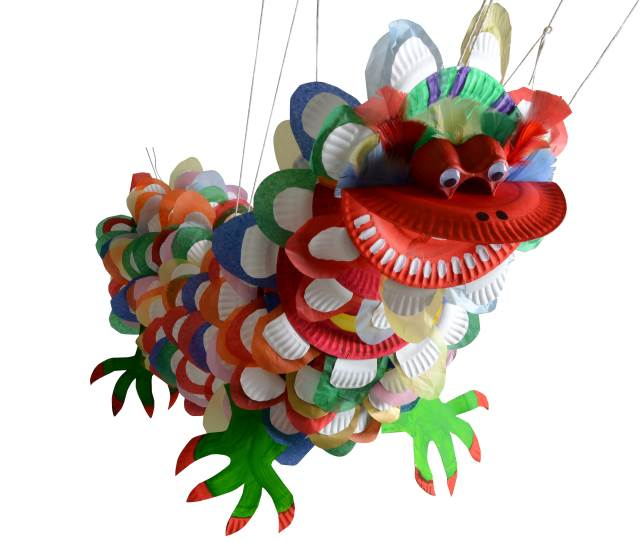 Chinese New Year Crafts - a fantastic Chinese New Year Dragon made from Paper Plates. The kids will adore this.