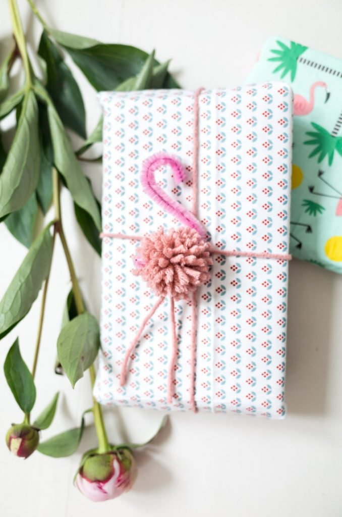 Flamingo Pom Pom Gift Wrap Idea - these look super cute as a flaming pom pom garland too!